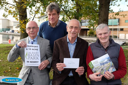 Riverside Church Trustee, Clifford Watt; Minister, Nigel Agnew and Treasurer, Noel McCune are pictured presenting the cheque to Alan Cleland, Newry 2020 at the Albert Basin, the proposed site for the city park. Photograph: Columba O'Hare
